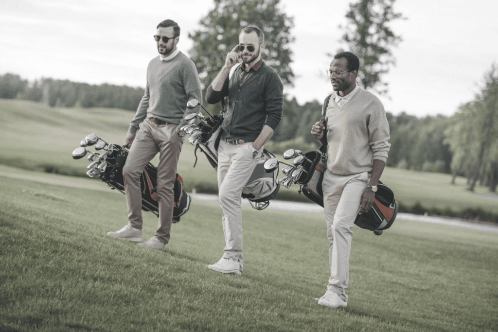 3 men dressed stylish on golf course