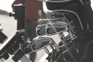 set of irons in stand golf bag