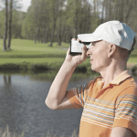 man looking through golf rangefinder