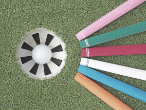 golf grips pointing at hole with golf ball