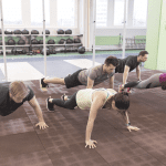 group of people doing pushups