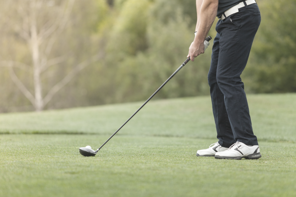 picture of left handed golfer on the tee box with driver