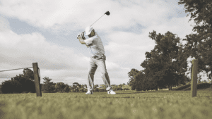 senior golfer hitting off the tee