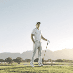 Male golfer standing on tee box