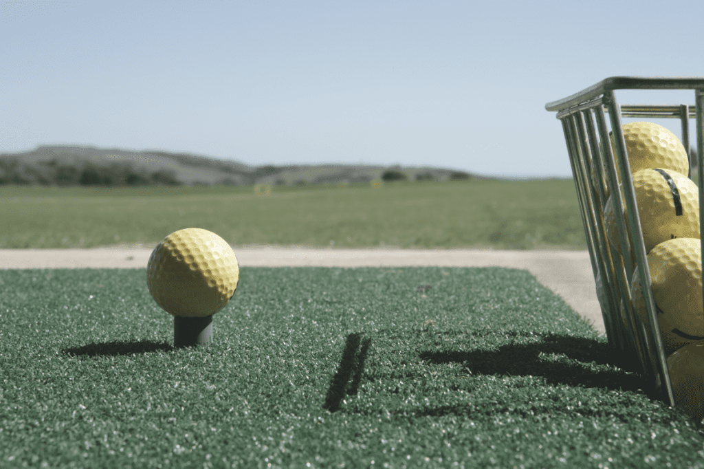 Golf ball on a rubber tee at the driving range