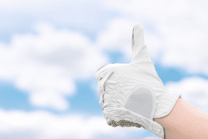 thumbs up gesture with hand in golf a golf glove