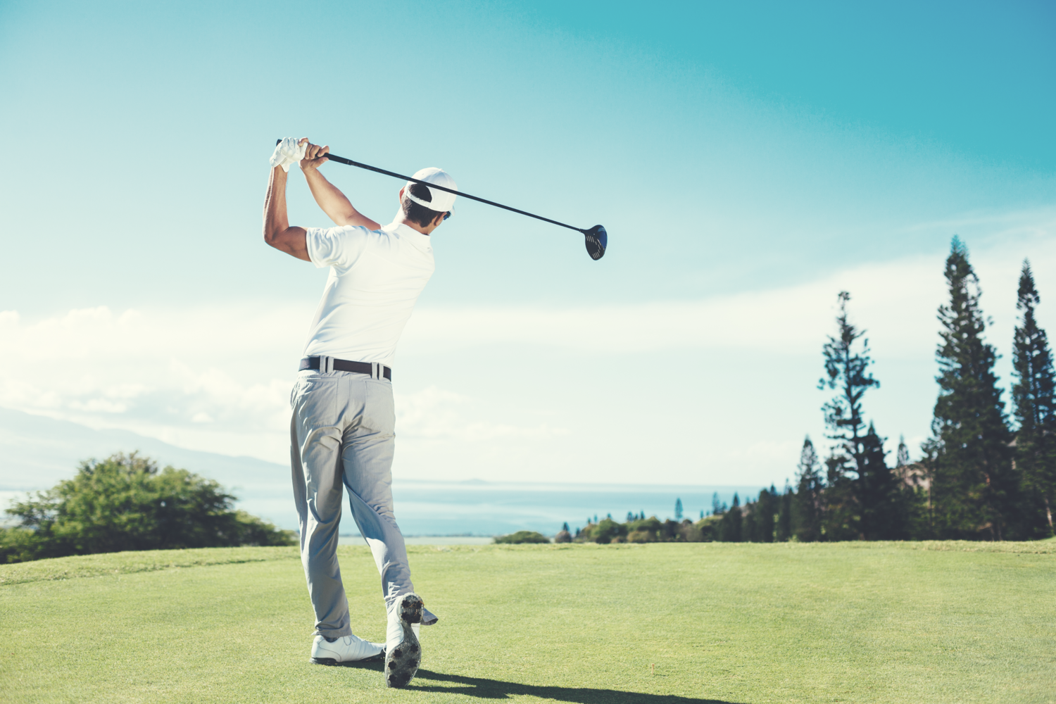 man holding pose after hitting driver off the tee