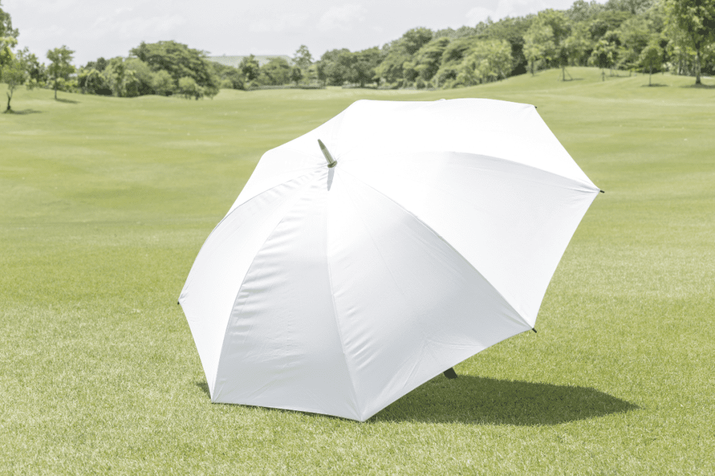 white umbrella on the fairway