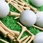 Tees and golf balls on a golf mat